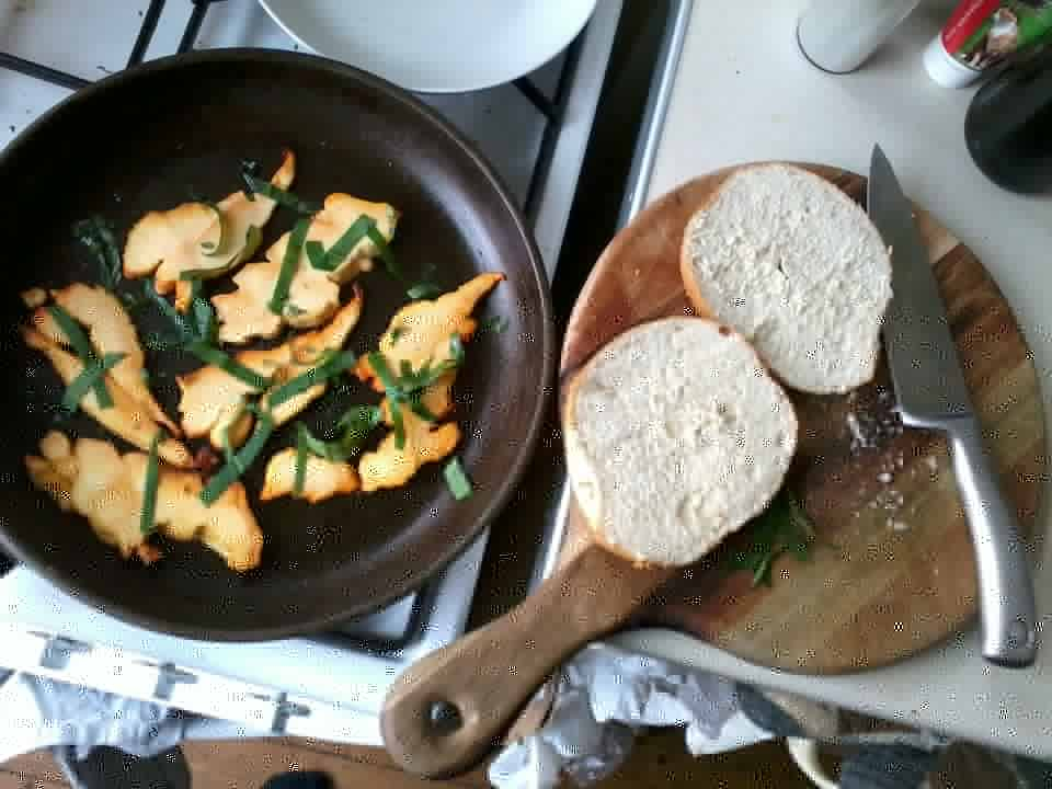 Cooking chicken of the woods with wild garlic leaves